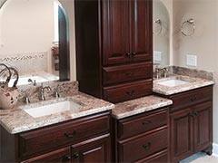 This master bathroom showcases beautiful custom vanities