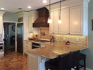 Kitchen remodel with custom cabinetry and custom tile work