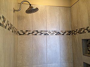 Broken shower was replaced with new, custom tiled shower