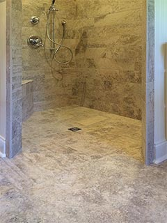 This accessible shower stall showcases custom tile work as well as barrier free design