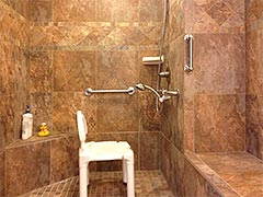 Spaciousness and safety are part of this accessible shower as well as beautiful custom tile work
