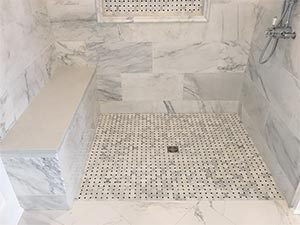 Barrier free curbless custom marble shower design